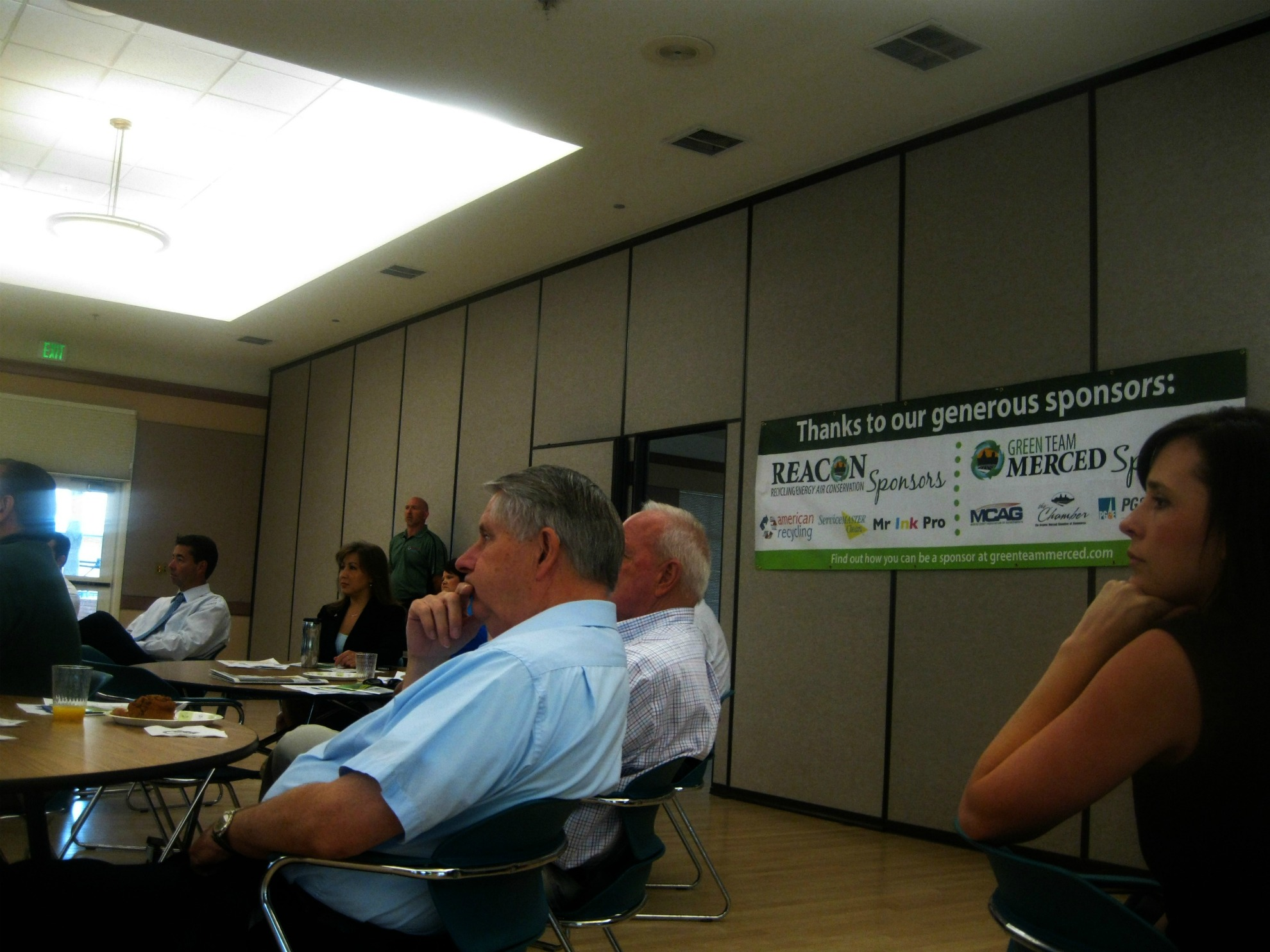 Greater Merced Chamber of Commerce members listen to a presentation of upcoming commercial recycling changes in the county at the Green Team Merced's September meeting.