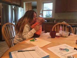 Nicole Coryell of Ventura kisses her 2-month-old daughter. Photo: Claudia Boyd-Barrett